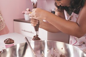 Woman chef baking cupcakes