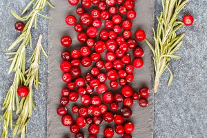 Fresh red cranberries and rosemary