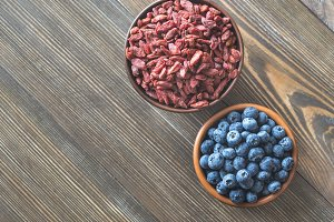 Bowls of blueberries and goji