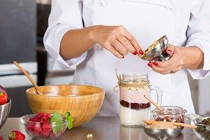 Cook making a dessert