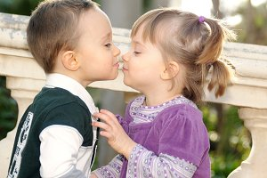 Girl and boy kissing tenderly