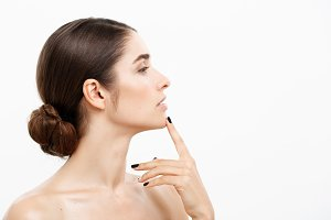 Beauty Skin Care Concept - Beautiful caucasian woman face portrait touching her chin with finger shocked and worried with acne isolated on white.