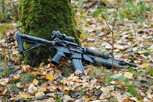 Firearms In The Fall ForestM4A1 carbine with M203 grenade launcher