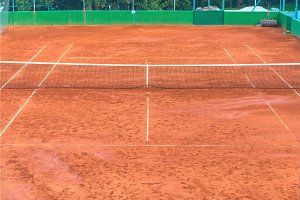 Large clay tennis court without people