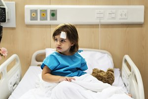 Young sick girl staying in hospital