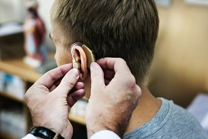 A man having his ears checked