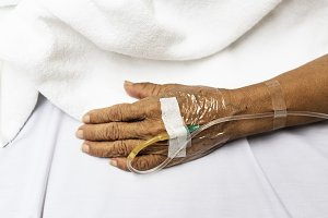 IV tube on patient hand