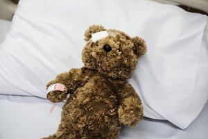 An injured teddy bear in hospital