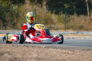 Karting - driver in helmet on kart circuit