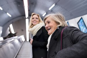 Two women standing at the escalator in Vienna subway
