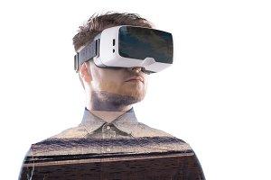 Double exposure. Man wearing virtual reality goggles. Sea beach.