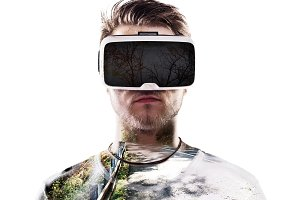 Double exposure. Man wearing virtual reality goggles. Road.