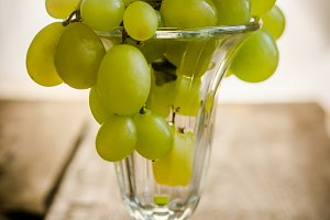 Bunch of grapes in the glass