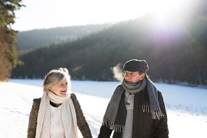 Beautiful senior couple on a walk on sunny winter day
