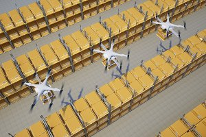 drones with boxes fly above the warehouse