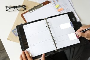 person working on notepad (PNG)