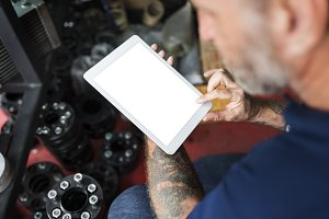 repair man working on tablet (PNG)