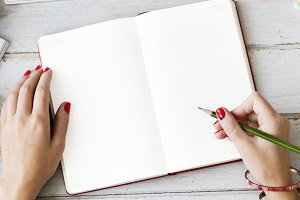 Hands writing in a notebook (PNG)