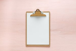 Blank folder tablet isolated on pink copy space background. Minimalistic feminine flat lay for bloggers, designers, sites