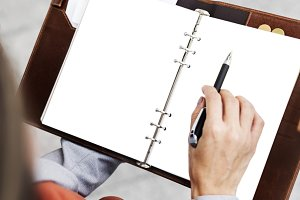 hands working on notepad (PNG)