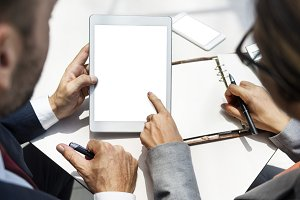 colleagues working on tablet (PNG)