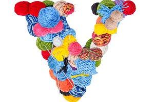 Letter V made of knitting yarn