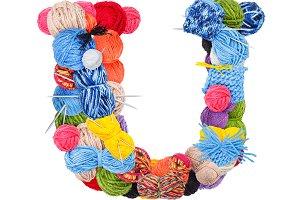 Letter U made of knitting yarn
