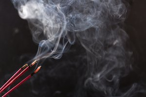 various incenses on black background