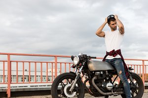 Handsome man and nice caferacer bike