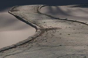 Cracked asphalt path