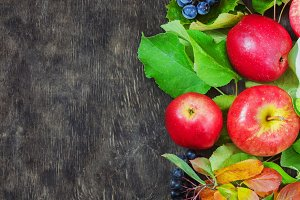 Assortment organic fruits berries apple grape damascene rowanberry dark wooden country background health care natural concept top view