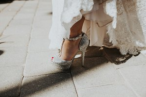 Bride Showing Off Her Wedding Shoes