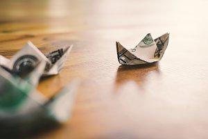 dollar boat on wood