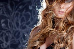 beautiful girl , facial hair, a gust of wind