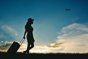 Silhouette of women travel