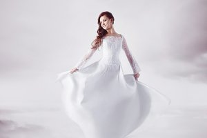Beautiful bride in wedding dress, abstract soft background