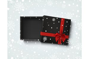Opened black empty gift box with red ribbon and bow.