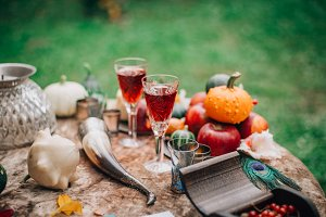 Fall table with wine and pumpkins