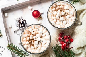 Christmas hot chocolate or cocoa with marshmallow on white.