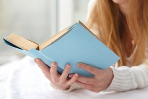 Woman holding book close up