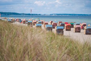 Sandy beach and traditional wooden beach chairs. Northern Germany, on the coast of Baltic Sea
