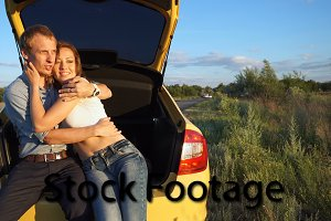 Loving couple in car. Road Trip