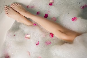 pink rose petals in a round tub