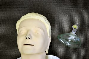 First aid medical practice dummy mannequin and assisted breathing mask