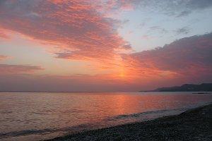 Fantastic orange blue sea ocean sunset shore cloud sky photo