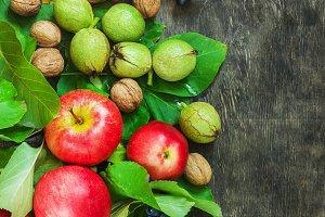 Assortment organic fruits berries apple grape damascene walnut rowanberry dark wooden country background health care natural concept top view
