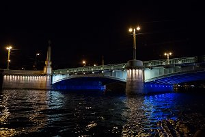 Night cityscape with river and bridge in Saint-Petersburg .