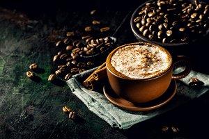 Cup of delicious cappuccino in arrangement