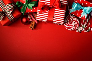 Various gifts on red background