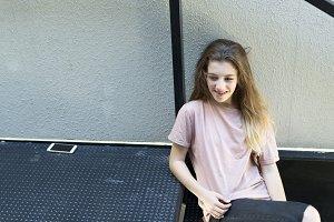 Teenage girl smiling sitting